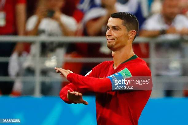TOPSHOT Portugal's forward Cristiano Ronaldo reacts during the Russia 2018 World Cup Group B football match between Iran and Portugal at the Mordovia...