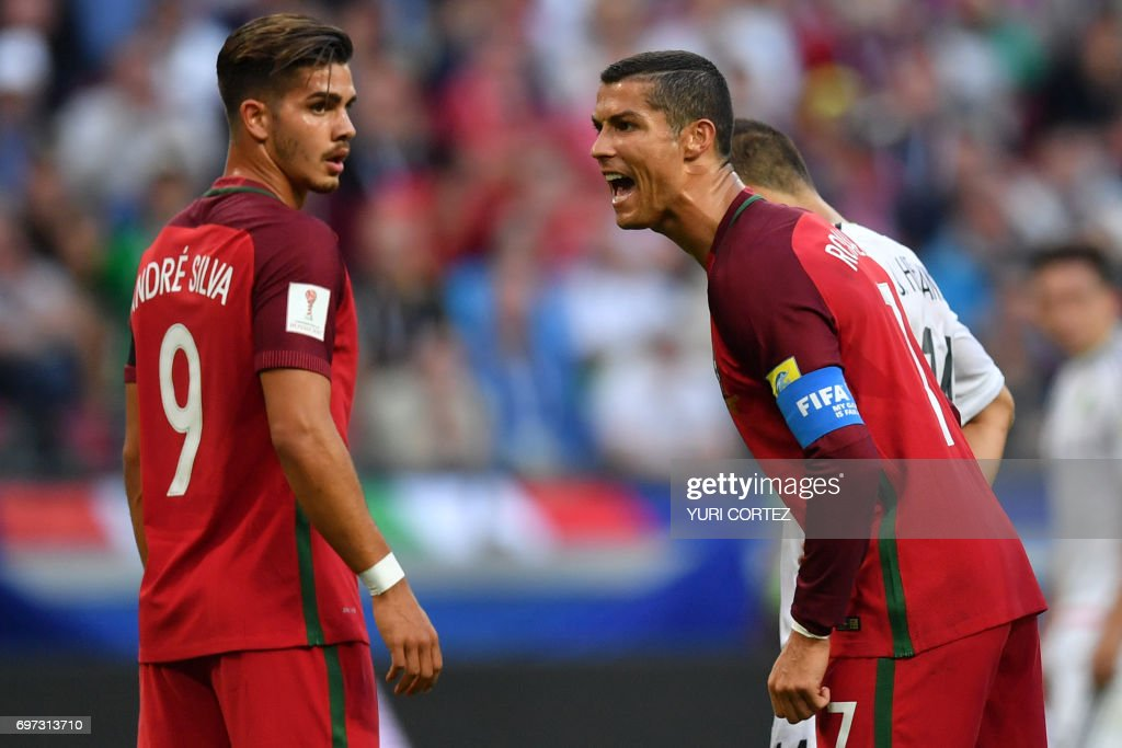 TOPSHOT - Portugal's forward Cristiano Ronaldo (R) reacts next to Portugal's forward Andre Silva during the 2017 Confederations Cup group A football match between Portugal and Mexico at the Kazan Arena in Kazan on June 18, 2017. / AFP PHOTO / Yuri CORTEZ