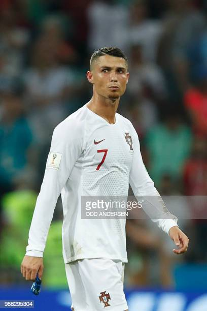 Portugal's forward Cristiano Ronaldo reacts to his teams loss during the Russia 2018 World Cup round of 16 football match between Uruguay and...