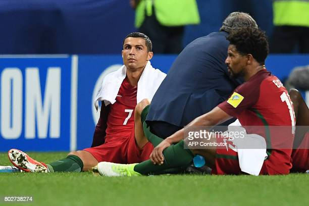 Portugal's forward Cristiano Ronaldo rests before overtime during the 2017 Confederations Cup semifinal football match between Portugal and Chile at...