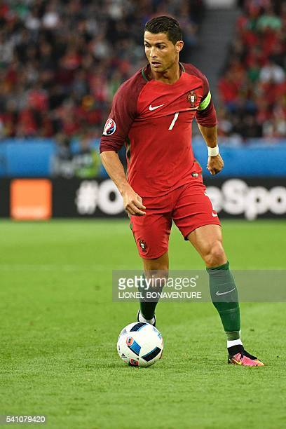 Portugal's forward Cristiano Ronaldo runs with the ball during the Euro 2016 group F football match between Portugal and Austria at the Parc des...