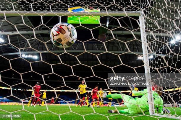 Portugal's forward Cristiano Ronaldo scores a free kick past Sweden's goalkeeper Robin Olsen, his 100th goal for Portugal, during the UEFA Nations...