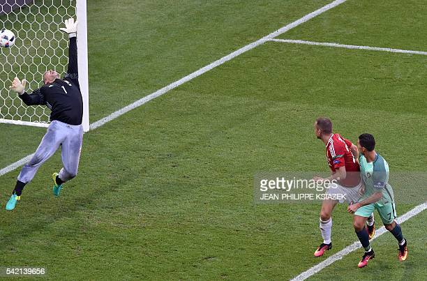 TOPSHOT Portugal's forward Cristiano Ronaldo scores a goal during the Euro 2016 group F football match between Hungary and Portugal at the Parc...