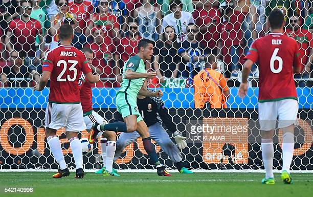 Portugal's forward Cristiano Ronaldo scores a goal during the Euro 2016 group F football match between Hungary and Portugal at the Parc Olympique...