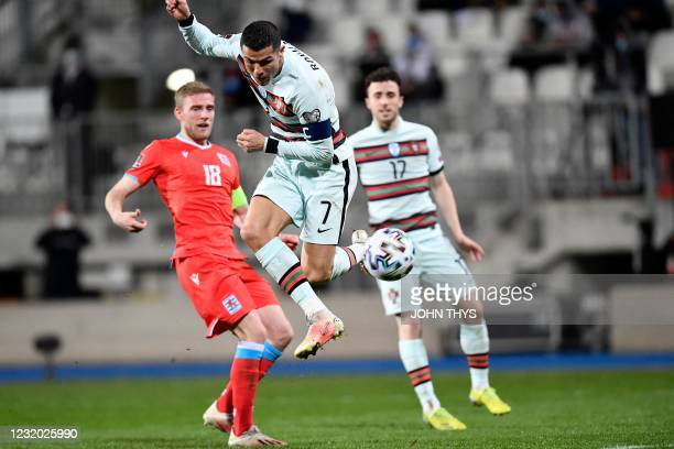 Portugal's forward Cristiano Ronaldo scores a goal during the FIFA World Cup Qatar 2022 qualification Group A football match between Luxembourg and...