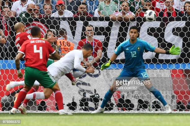 TOPSHOT Portugal's forward Cristiano Ronaldo scores a header during the Russia 2018 World Cup Group B football match between Portugal and Morocco at...