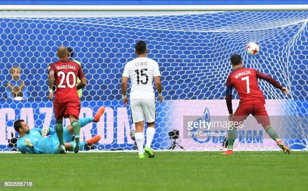 TOPSHOT Portugal's forward Cristiano Ronaldo scores a penalty during the 2017 Confederations Cup group A football match between New Zealand and...