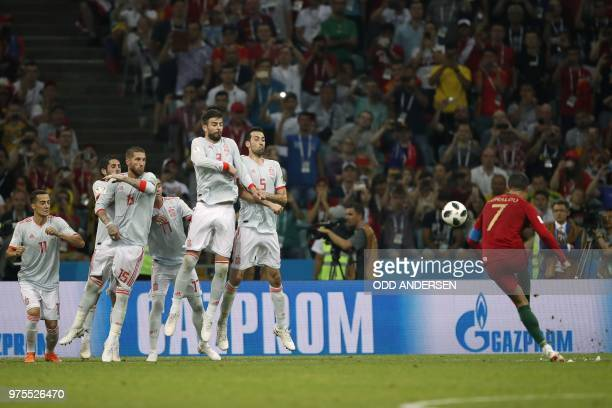 Portugal's forward Cristiano Ronaldo scores his third goal from a freekick during the Russia 2018 World Cup Group B football match between Portugal...
