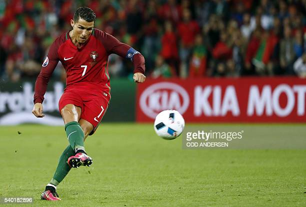 Portugal's forward Cristiano Ronaldo shoots a free kick during the Euro 2016 group F football match between Portugal and Iceland at the...