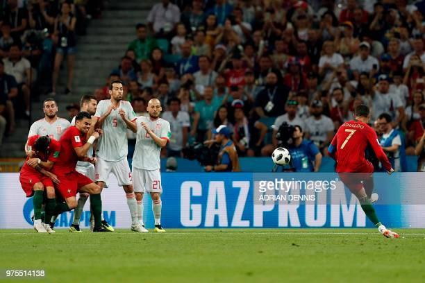 Portugal's forward Cristiano Ronaldo shoots a free kick during the Russia 2018 World Cup Group B football match between Portugal and Spain at the...