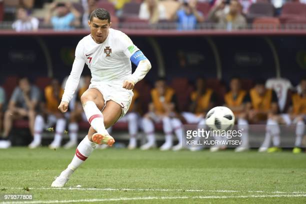 Portugal's forward Cristiano Ronaldo shoots a free kick during the Russia 2018 World Cup Group B football match between Portugal and Morocco at the...