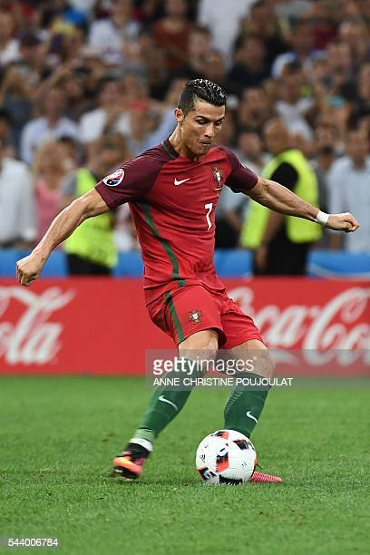 Portugal's forward Cristiano Ronaldo shoots and scores the first in a penalty shoot-out during the Euro 2016 quarter-final football match between...