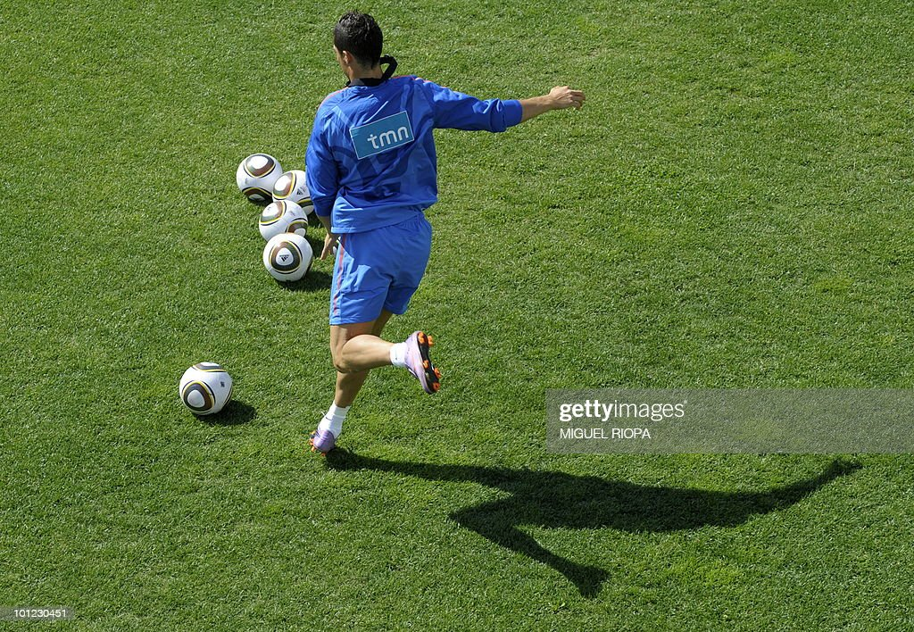 Portugal's forward Cristiano Ronaldo shoots the ball during their team´s morning session training at Covilha Sports Complex in Covilha, central Portugal, on May 28, 2010. Portugal is holding training camp in preparation for the upcoming WC2010 in South Africa.