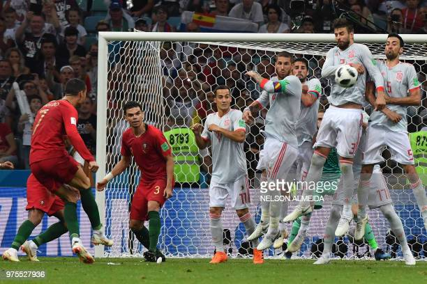 Portugal's forward Cristiano Ronaldo shoots to score his thrird goal during the Russia 2018 World Cup Group B football match between Portugal and...