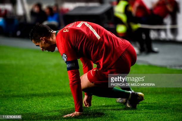 TOPSHOT Portugal's forward Cristiano Ronaldo sits on the pitch during the Euro 2020 qualifying group B football match between Portugal and Serbia at...