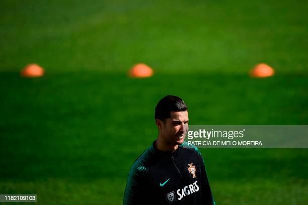 Portugal's forward Cristiano Ronaldo smiles during a training session at Algarve stadium in Faro on November 13 on the eve of the UEFA Euro 2020...