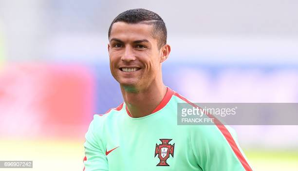 Portugal's forward Cristiano Ronaldo smiles during a training session at the Kazan Arena stadium in Kazan Russia on June 17 2017 on the eve of the...