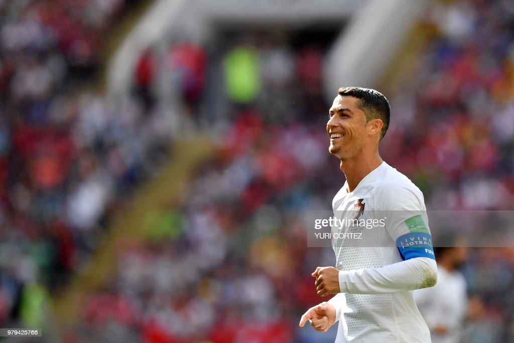 TOPSHOT - Portugal's forward Cristiano Ronaldo smiles during the Russia 2018 World Cup Group B football match between Portugal and Morocco at the Luzhniki Stadium in Moscow on June 20, 2018. (Photo by Yuri CORTEZ / AFP) / RESTRICTED