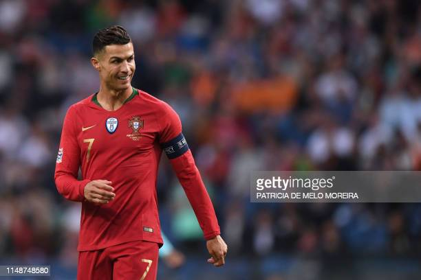 Portugal's forward Cristiano Ronaldo smiles during the UEFA Nations League final football match between Portugal and The Netherlands at the Dragao...
