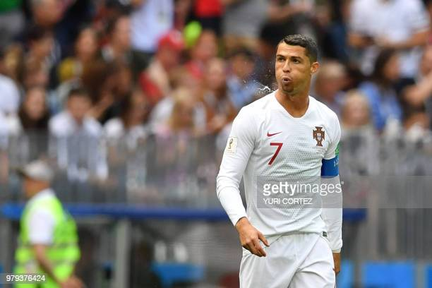 Portugal's forward Cristiano Ronaldo spits during the Russia 2018 World Cup Group B football match between Portugal and Morocco at the Luzhniki...