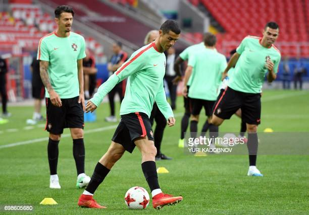 Portugal's forward Cristiano Ronaldo takes part in a training session with teammates in Moscow on June 20 2017 on the eve of the 2017 FIFA...
