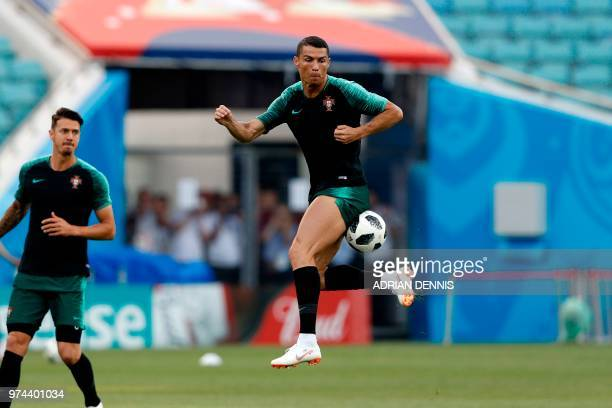TOPSHOT Portugal's forward Cristiano Ronaldo takes part in a training session at the Fisht Olympic Stadium in Sochi on June 14 on the eve of the...
