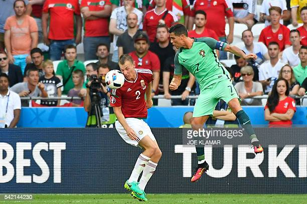 Portugal's forward Cristiano Ronaldo vies for the ball with Hungary's defender Adam Lang during the Euro 2016 group F football match between Hungary...