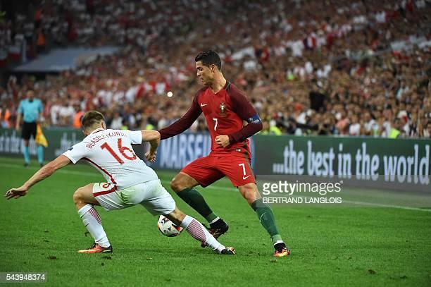 Portugal's forward Cristiano Ronaldo vies for the ball with Poland's midfielder Jakub Blaszczykowski during the Euro 2016 quarterfinal football match...