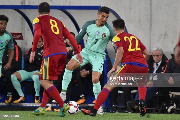 Portugal's forward Cristiano Ronaldo vies with Andorra's midfielder Victor Rodriguez and Andorra's midfielder Marcio Vieira during the FIFA World Cup...