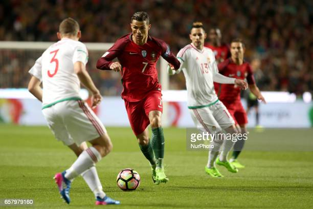 Portugal's forward Cristiano Ronaldo vies with Hungary's defender Mihaly Korhut during the FIFA World Cup Russia 2018 qualifier match Portugal vs...