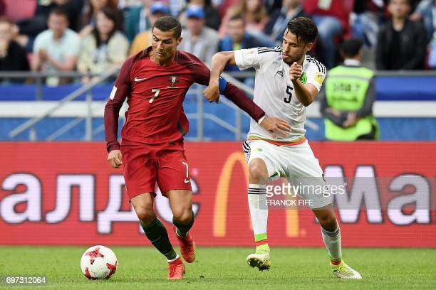 Portugal's forward Cristiano Ronaldo vies with Mexico's defender Diego Reyes during the 2017 Confederations Cup group A football match between...
