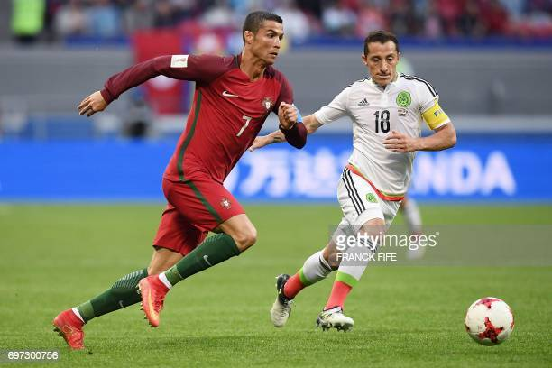 TOPSHOT Portugal's forward Cristiano Ronaldo vies with Mexico's midfielder Andres Guardado during the 2017 Confederations Cup group A football match...