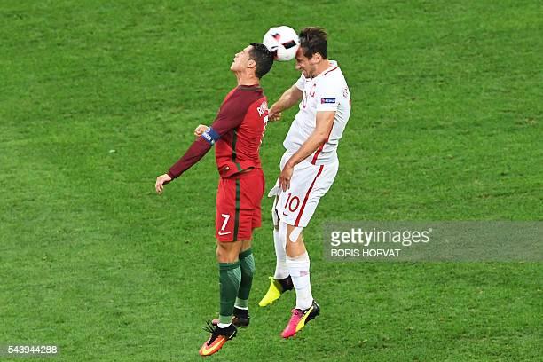 TOPSHOT Portugal's forward Cristiano Ronaldo vies with Poland's midfielder Grzegorz Krychowiak during the Euro 2016 quarterfinal football match...