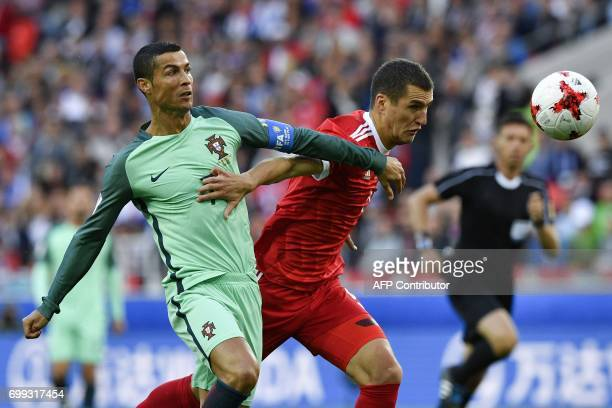 Portugal's forward Cristiano Ronaldo vies with Russia's defender Viktor Vasin during the 2017 Confederations Cup group A football match between...