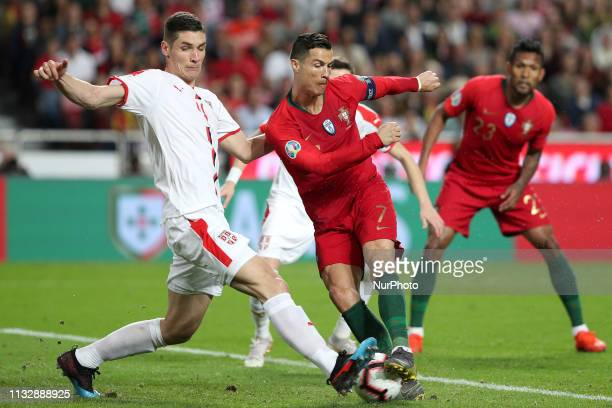 Portugal's forward Cristiano Ronaldo vies with Serbia's defender Nikola Milenkovic during the UEFA EURO 2020 group B qualifying football match...