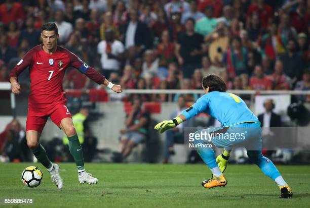 Portugal's forward Cristiano Ronaldo vies with Switzerland's goalkeeper Yann Sommer during the FIFA 2018 World Cup Qualifier match between Portugal...