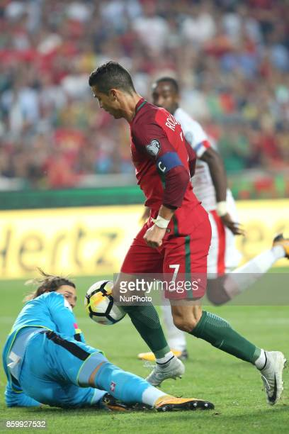 Portugal's forward Cristiano Ronaldo vies with Switzerland's goalkeeper Yann Sommer during the 2018 FIFA World Cup qualifying football match between...