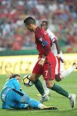 portugals forward cristiano ronaldo vies with