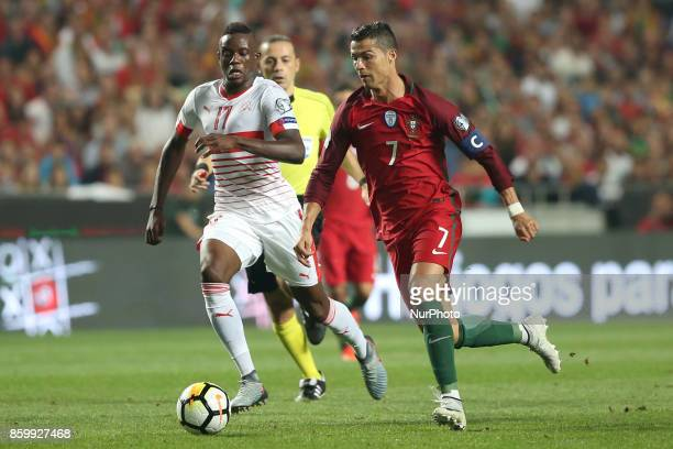 Portugal's forward Cristiano Ronaldo vies with Switzerland's midfielder Denis Zakaria during the 2018 FIFA World Cup qualifying football match...