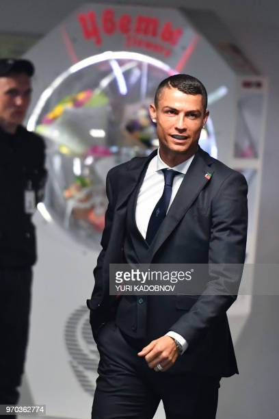 Portugal's forward Cristiano Ronaldo walks at the Zhukovsky airport about 40 kilometres southeast of Moscow city centre on June 9 as the Portugal's...
