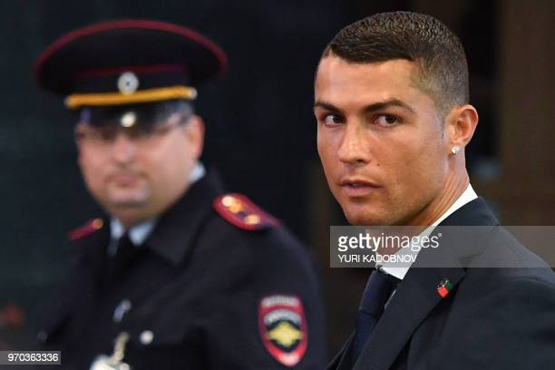 Portugal's forward Cristiano Ronaldo walks at the Zhukovsky airport, about 40 kilometres southeast of Moscow city centre, on June 9 as the Portugal's...