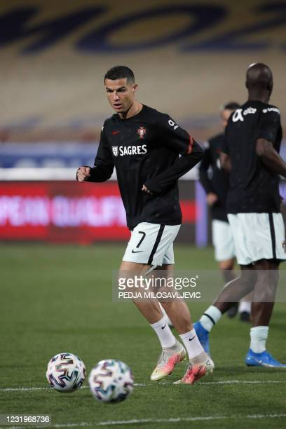 Portugal's forward Cristiano Ronaldo warms up ahead of the FIFA World Cup Qatar 2022 qualification Group A football match between Serbia and Portugal...