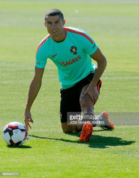 Portugal's forward Cristiano Ronaldo warms up during a training session at 'Cidade do Futebol' training camp in Oeiras outskirts of Lisbon on June 7...