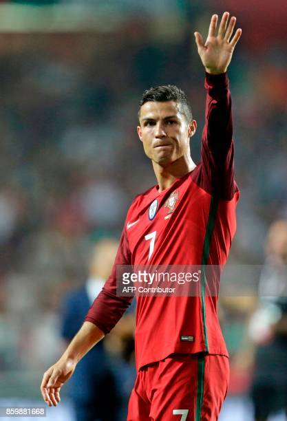 Portugals forward Cristiano Ronaldo waves during the FIFA World Cup 2018 Group B qualifier football match between Portugal and Switzerland at the Luz...