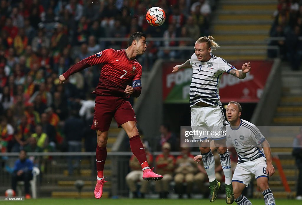 Portugal's forward Cristiano Ronaldo with Denmark's Simon Kjaer in action during the UEFA EURO 2016 Qualifier match between Portugal and Denmark at Estadio Municipal de Braga on October 8, 2015 in Braga Portugal.