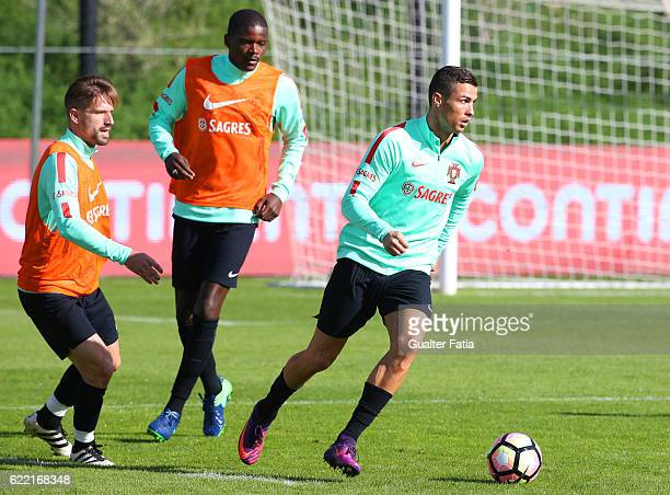 Portugal's forward Cristiano Ronaldo with Portugal's midfielder Adrien Silva and Portugal's midfielder William Carvalho in action during Portugal's...