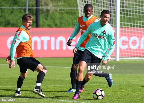 Portugal's forward Cristiano Ronaldo with Portugal's midfielder William Carvalho and Portugal's midfielder Adrien Silva in action during Portugal's...