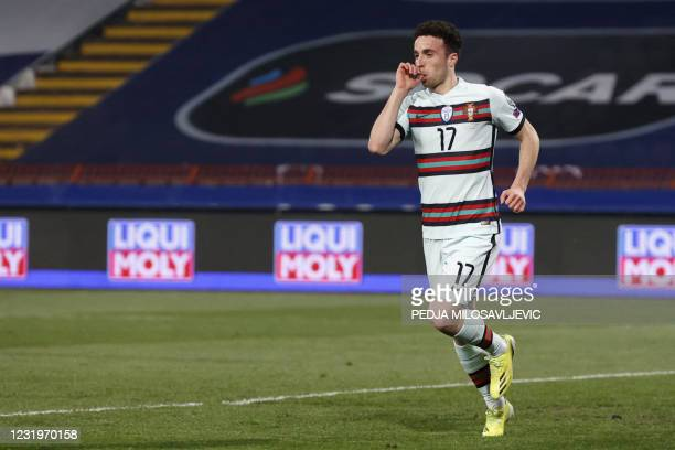 Portugal's forward Diogo Jota celebrates after scoring a goal during the FIFA World Cup Qatar 2022 qualification Group A football match between...