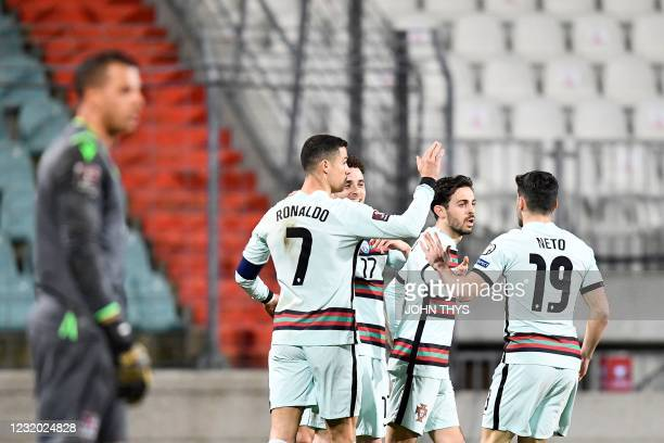 Portugal's forward Diogo Jota celebrates with teammates after scoring a goal during the FIFA World Cup Qatar 2022 qualification Group A football...