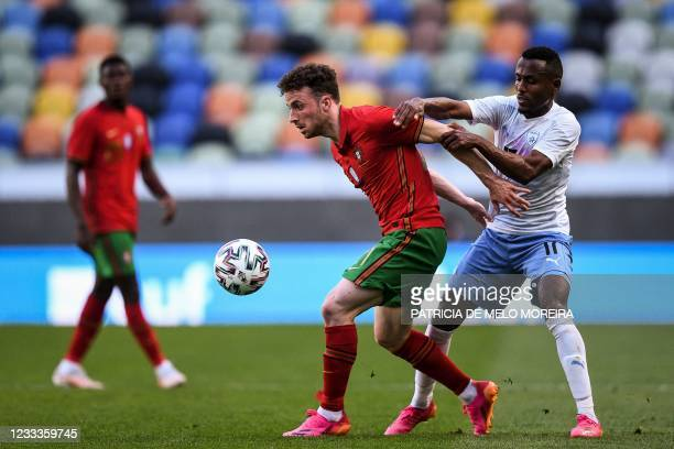 Portugal's forward Diogo Jota is challenged by Israel's midfielder Gadi Kinda during the international friendly football match between Portugal and...